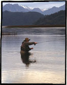 Fly fishing for trout with the Andes Mountains in the background. Photograph by Adrian Dufflocq, Cumilahue Fly Fishing Lodge.